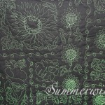 Sunflowers, leaves and double loops (back): Custom free motion quilting on quilt pieced by Janie M.