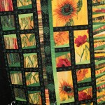 Sunflowers, leaves and double loops: Custom free motion quilting on quilt pieced by Janie M.