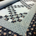 Feathers and apple cores: Custom free motion quilting on quilt pieced by Agnes H.