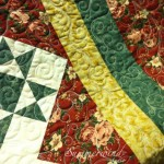 Vines and feathers: Custom free motion quilting on quilt pieced by Agnes H.