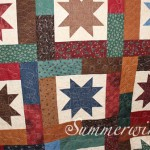QOV pieced by Harriet R. and custom quilted.