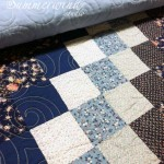 Swirls: Semi-custom free motion quilting on quilt pieced by Agnes H.